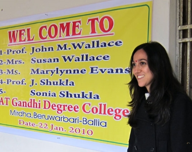 Sonia Shukla in front of Welcome sign at Gandhi College