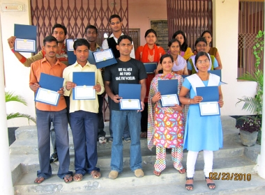 Students with certificates of completion for the 2010 English Workshop